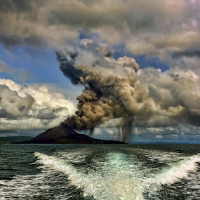 Running Away by F.N. Hendrawan - Landscapes Mountains & Hills ( clouds, explosion, dust, sunda strait, boat )