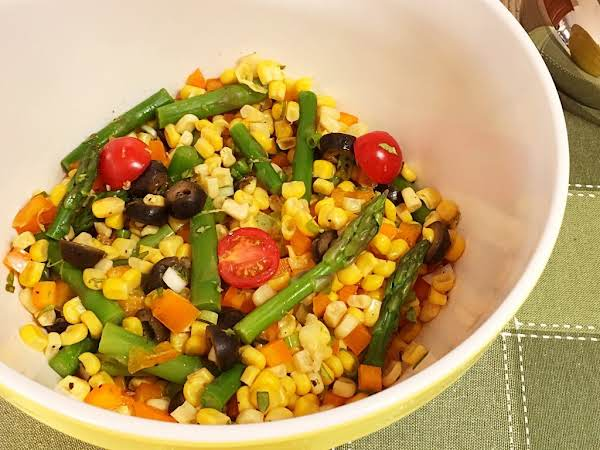A Vegetable Salad In A Yellow Bowl.
