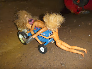 Photo: Barbies & Ken making it on a tractor