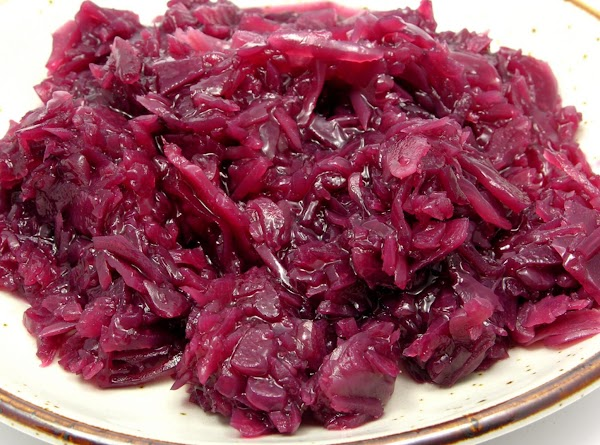 Pour sauce over cooked cabbage in bowl, add butter, and mix gently.  Keep...