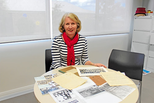Narrabri Public School principal Marion Tame with some of the memorabilia she has been sent by past students ahead of the 150th anniversary celebrations.
