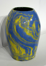 """Photo: """"A Pot a Day, 4/22/11"""" A marbling experiment: mason stains were added to porcelain to make the yellow and blue colors. The two were briefly wedged to intermingle the colors. A clear glaze is applied to the surface."""