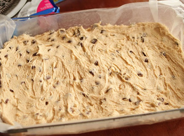 Spread the cookie dough in the bottom of a 9×13 baking dish that's been...