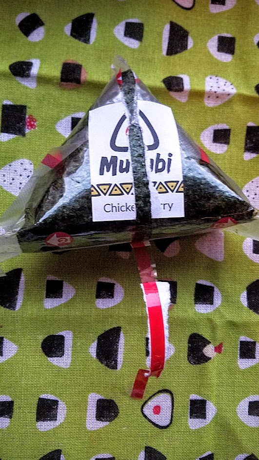 Musubi in Portland, the onigiri is carefully packaged in plastic with a red strip guiding you how to open it- and it keeps it separate so the seaweed stays crispy and dry away from the more moist rice portion until the moment of consumption and you bring it together.