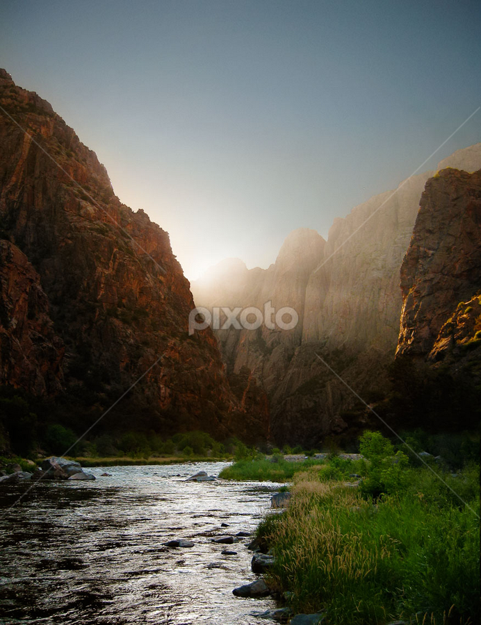 Heavens Gate by James Manning - Landscapes Mountains & Hills ( water, cliffs, grass, colorado, canyon, rock, places, travel, morning, sun rays, mountains, nature, sunrise, black canyon, light, river )