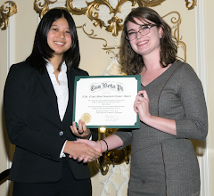 Photo: Awards Committee Vice ChairMichelle Harr presents Florida Theta President Kathryn Chung with the R.H. Nagel Most Improved Chapter Award.