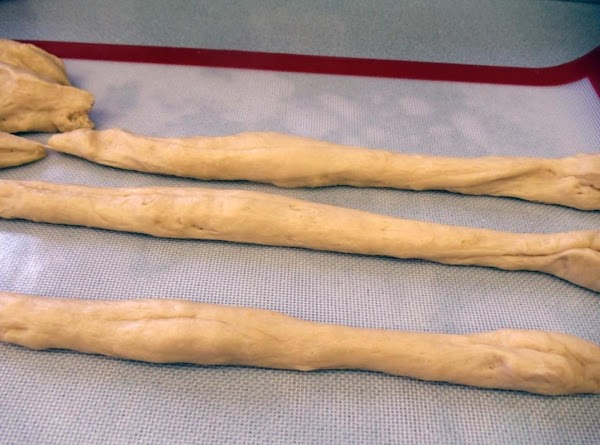 Cut dough into 6 pieces and roll each piece into a rope.