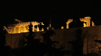 Photo: Construction cranes lit up by night. Oh, and you can see the Parthenon too.