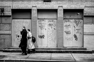 Photo: occupy our future when 2 people are in sync, you will see that they walk together. Both with the same foot in the same position. here they are in opposition. new york city 2012 www.leannestaples.com #newyorkcityphotography  #blackandwhitephotography  #graffiti  #streetphotography +Arnold Goodwayfor #streetpics  #shootthestreet