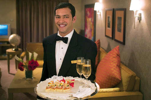 seven-seas-voyager-butler-canapes.jpg - A butler serves canapes and Champagne in suite during a Regent Seven Seas cruise.