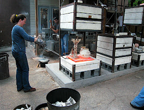 Photo: Be taking the top of the candelabra out of the raku kiln