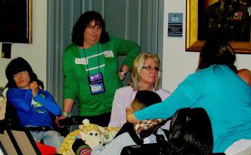 Photo: Brigitte Hancharick, Terri Hancharick and Pat Maichle speak with Nancy Lemus and her son.