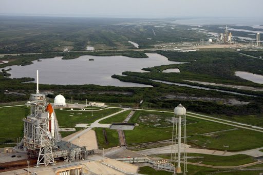 An aerial view of the Launch Complex at NASA's Kennedy Space Center shows space shuttles on both pads.