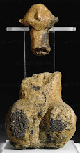 Photo: Sitting male clay figurine.  Red-yellowish paint.  From the Middle Neolithic circular ditch at Scheltz, Austria.