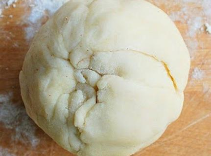 Wrap the dough around the apple until it's completely covered and looks like a...