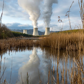 Being on the edge by Martin Namesny - Buildings & Architecture Other Exteriors ( mirror, water, reed, reflection, surface, power station, lake, chimneys, chimney, smoke )