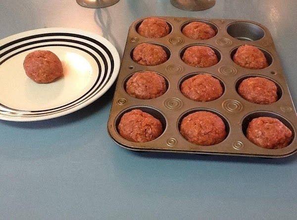 Lightly spray muffin pan with cooking spray. Press or roll your meat mixture into...