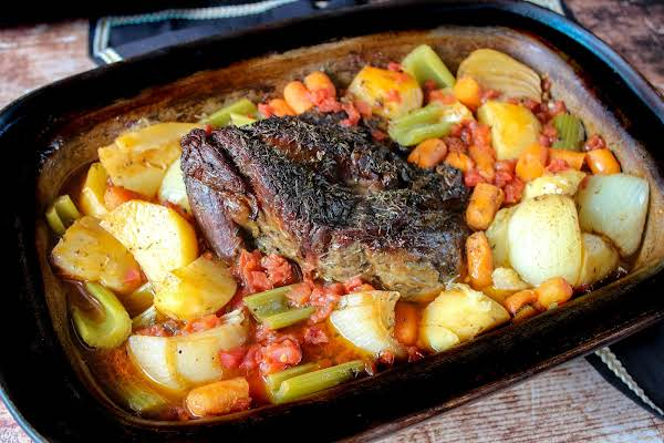 Thyme And Garlic Chuck Roast With Veggies Ready To Be Served.