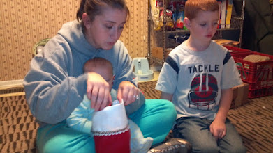 Photo: Stuffing the stockings was a family affair for Sam and her boys!