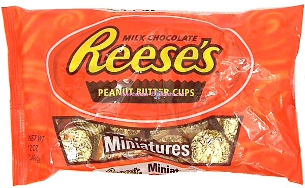 """open the reeses miniatures and using the white icing from tube """"glue"""" a reeses..."""