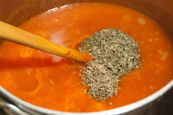 Add the basil, thyme, salt, and cayenne.