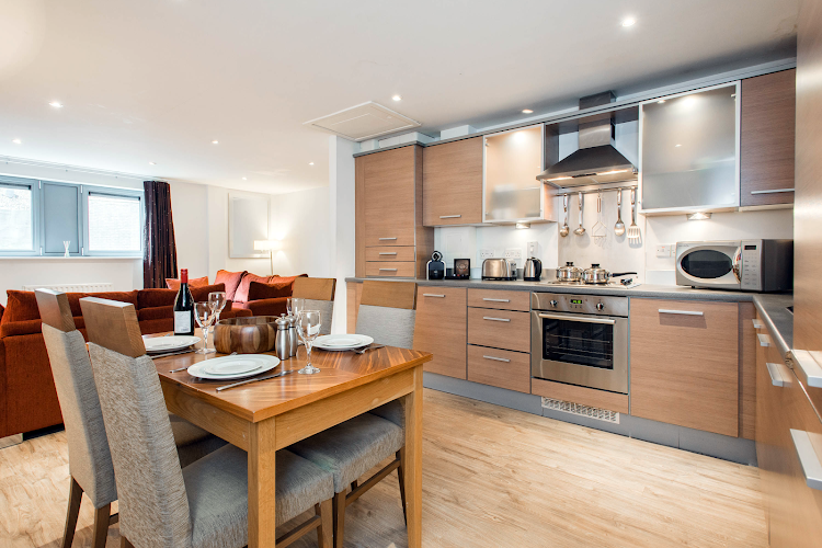 Fully equipped kitchen at PREMIER SUITES Newcastle