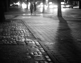 """Photo: """"Nocturne...""""  Over glistening cobblestones in the haze of summer heat, the twinkling lights of oncoming cars cast their glow like fireflies in a dense urban forest.  As somnambulists glide over uneven paths, the wind plays a nocturne.  This is when the city dreams.    New York Photography - Cobblestones at night, Central Park.    You can view this post along with information about purchasing prints of this image if you wish at my site here:  http://nythroughthelens.com/post/25999465866/night-central-park-new-york-city-over  -  Tags: #photography  #poetry  #prose  #nyc  #newyorkcity  #newyorkcityphotography  #night  #romance  #romantic  #cobblestone  #centralpark  #blackandwhite  #blackandwhitenewyorkcityphotography"""