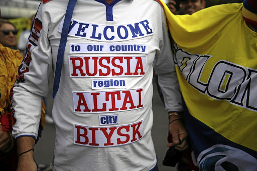 A fan sports a t-shirt welcoming visitors to Russia, outside the Luzhniki Stadium in Moscow, before the Soccer World Cup opener between Russia and Saudi Arabia. Picture: REUTERS