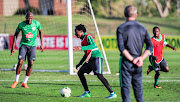 Bafana Bafana head coach Stuart Baxter keeps an eye on left back Sfiso Hlanti (L) striker Percy Tau (C) and midfielder Siphesihle Ndlovu during the South Africa training session at Princess Magogo Stadium on September 3 2018.