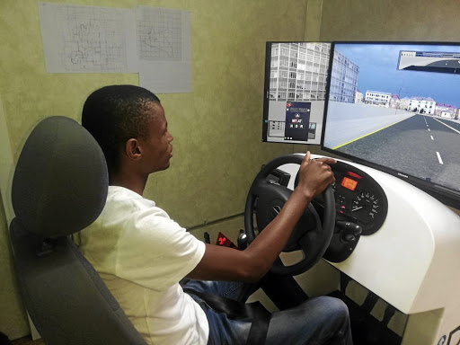 A student learns how to drive in a Dunga simulator.