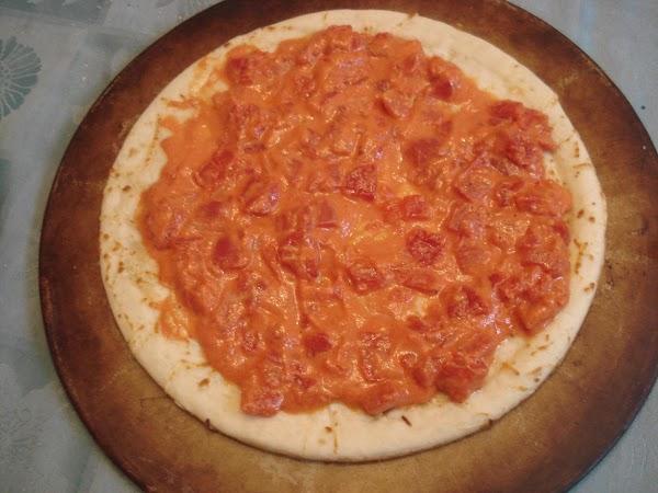 Spread sauce evenly over the dough