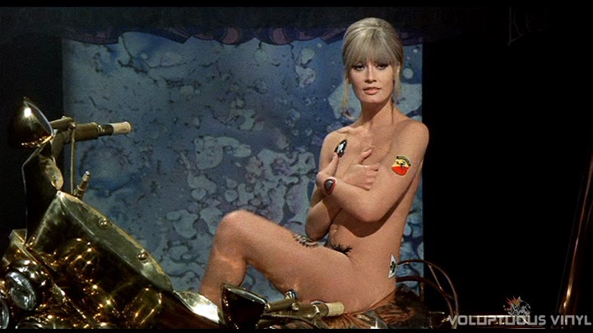 Marisa Mell nude striptease on a motorcycle.