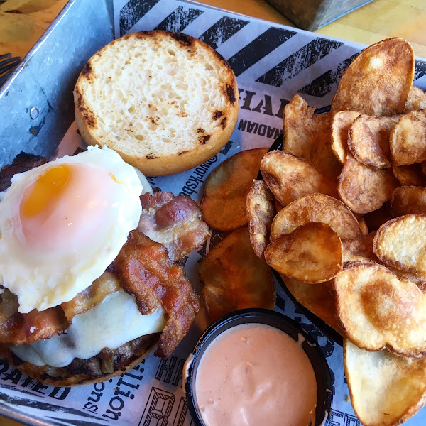 Elk Mancave Burger with an egg on top. Spicy die cut chips with chipotle sauce.