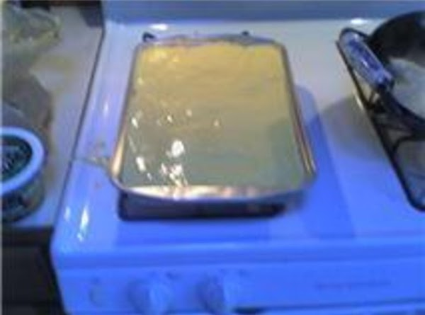 Follow directions on box and prepare cake mix.  Pour over fruit and marshmallow...