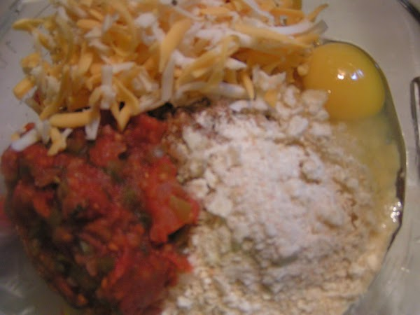 Combine ground beef, onion, crackers, taco seasoning, salt & pepper with 1 cup cheese...