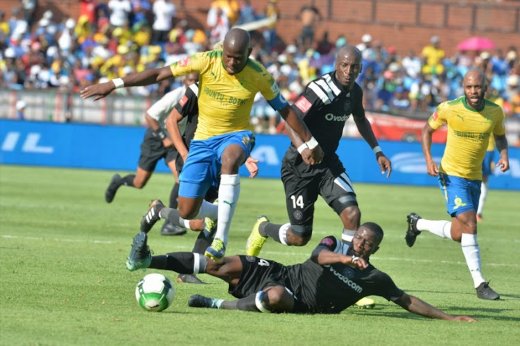 Hlompho Kekana of Mamelodi Sundowns and Ntsikelelo Nyauza of Orlando Pirates during the Absa Premiership match between Mamelodi Sundowns and Orlando Pirates at Loftus Versfeld Stadium on January 13, 2018 in Pretoria, South Africa.