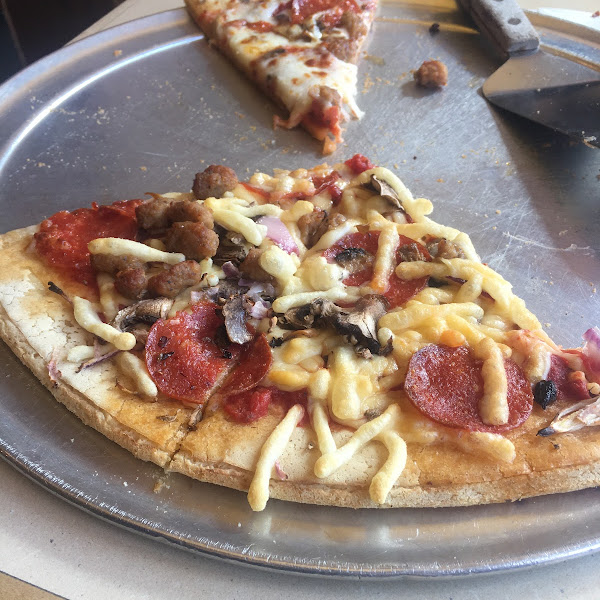 We had GF Railroad pizza - our server Bran made lunch a fun experience! Check out photo - the soy cheese bubbles up! Although my hubs is not GF, he said crust was delicious! Try it - you'll love it!