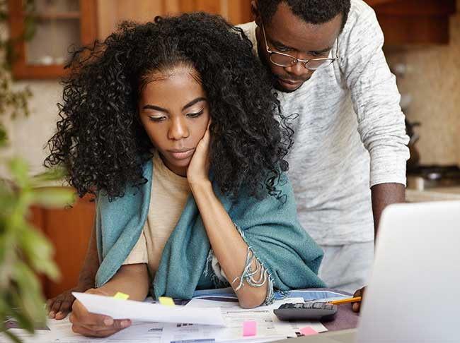 couple worried about house debt