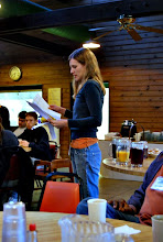 Photo: Lauren Caldwell making announcements on the Workshops for Saturday