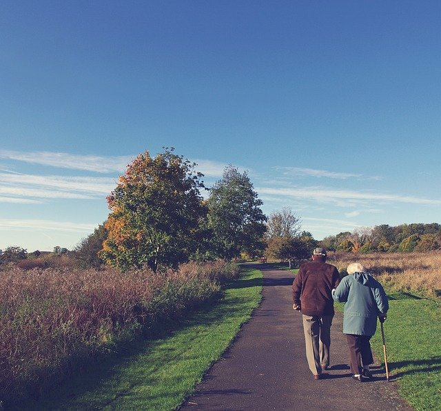 An old couple going for a walk