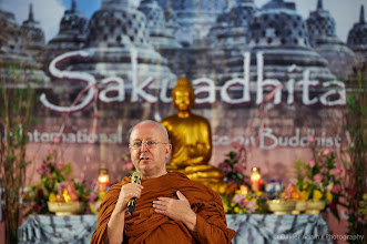 "Photo: Amazing light tonight during Ajahn Brahm on ""Buddhism with Compassion, Buddhism with Justice"" at Sakyadhita Conference. Courtesy of Olivier Adam."