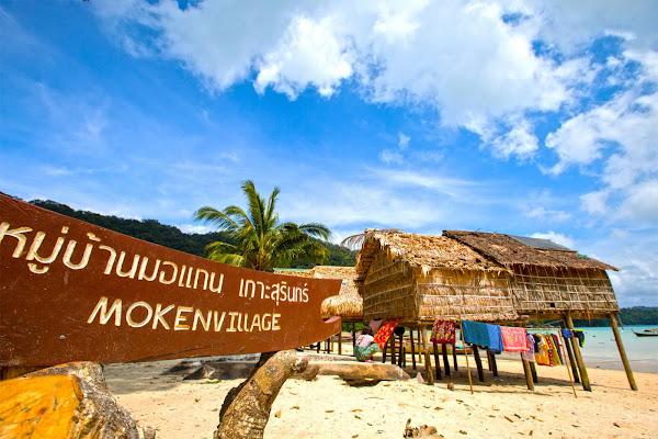 Slowely cruise past the Moken village on Surin Island