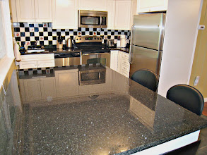 Photo: GARDEN LEVEL KITCHEN - ALL GRANITE COUNTERS AND STAINLESS STEEL APPLIANCES
