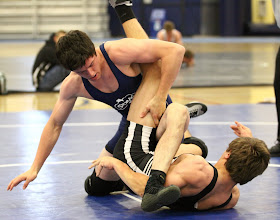 Photo: 152 pounds - 1st: Brandon Kingsley (Apple Valley) won by decision over Adam Cooling (Madelia Truman Martin Luther) (Dec 5-0)