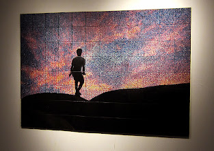 """Photo: """"Garden of the Gods"""" Ninety-six six-inch tiles form this piece. Based on a photo taken at the Garden of the Gods in southern Illinois of my son jumping over boulders. Although not evident in the image, there are tremendous drops between the boulders, which I believe is reflected in his cautious posture."""