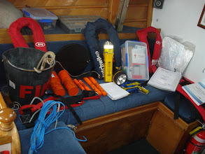 Photo: Our safety equipment, EPIRB, First Aid, Life Jackets, Rocket flares, Hand flares, Smoke flares, Radar reflector, Motoring signals, Fire extinguishers, Fire & bailing buckets, Touches, Charts, Almanacs, MOB lights, Safety harness's, Grapnel, Nav equipment and more!!!