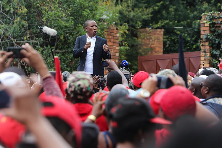 EFF leader Julius Malema addresses party supporters after visiting the family home of Anti-Apartheid Activist Winnie Madikizela Mandela in Orlando West, Soweto.