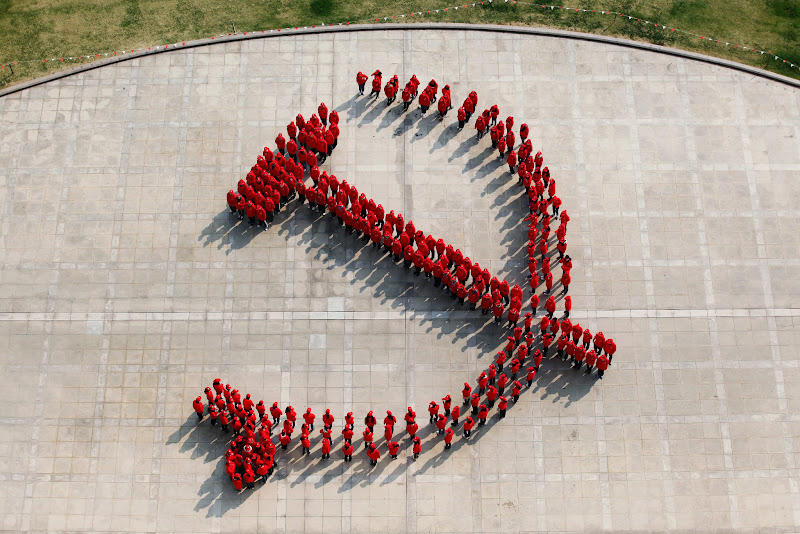 Photo: Student members of China's ruling elite stand in formation to create the Communist Party's emblem, a hammer and sickle ahead of the 18th National Congress meeting this week.