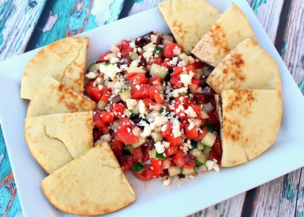 Line the outer portion of the dish with the pita bread.  Sit back...