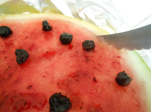 Cut the water melon  around the corner (Put a sharp knife between the...